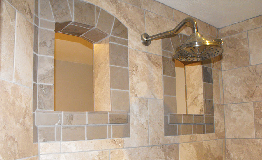 Old-world stone and porcelain mixed to create shower