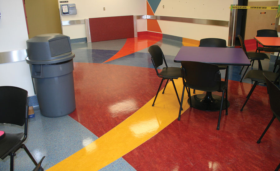 Arcs on floor meet with wall paint designs