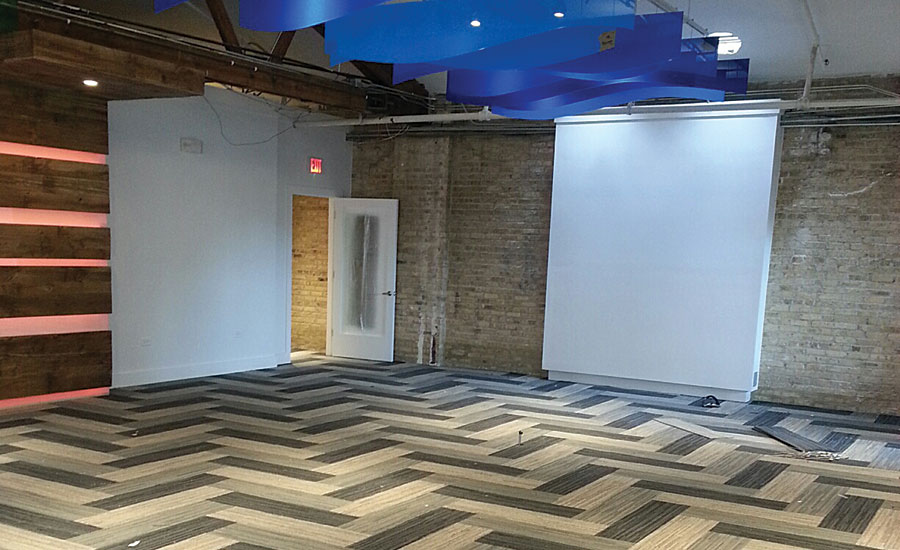 Installation incorporates 6-color carpet tile