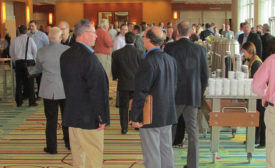 Attendees wait to enter trade show