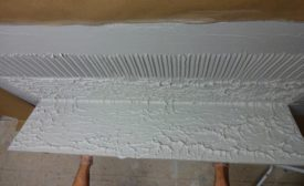 comb mortar parallel to short side of tile