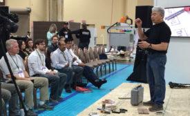Jon Namba giving presentation at TISE