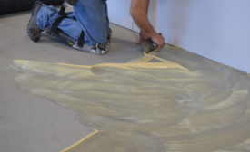 applying TEC TrowelFast Flooring Adhesive