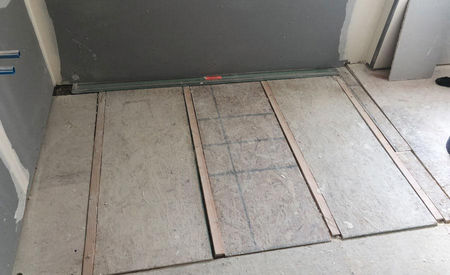 installing a linear drain next to a wall