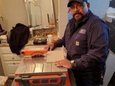 Triniti Virgil working with tile saw