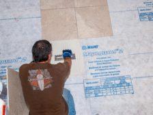 installing crack isolation membrane