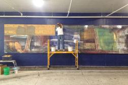 Jan Hohn finishing up the 'Trainscape' mural