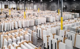 his facility houses corporate office spaces for eight departments and nearly 100,000 square feet of space solely dedicated to quartz storage